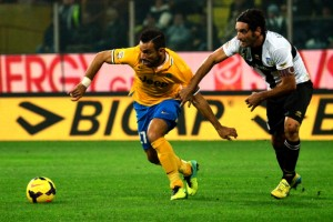 "Juventus' forward Fabio Quaglierella (L) fights for the ball with Parma's midfielder Alessandro Lucarelli during their Serie A football match Parma vs Juventus at ""Tardini Stadium"" in Parma on November 2, 2013. AFP PHOTO / GIUSEPPE CACACE        (Photo credit should read GIUSEPPE CACACE/AFP/Getty Images)"