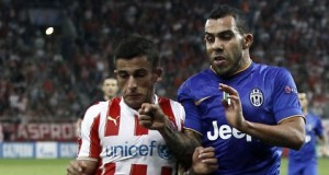 Juventus__Tevez_challenges_Olympiakos__Elabdellaoui_during_their