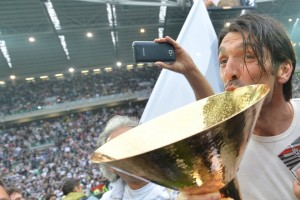 Juventus' goalkeeper Gianluigi Buffon kisses the Italian Serie A football trophy, the Scudetto, during a ceremony after the team's match against Atalanta on May 13, 2012 in Juventus stadium in Turin. Juve have officially won 28 titles due to having been stripped of their 2005 and 2006 successes for match-fixing and forward Alessandro Del Piero's 19-year stay with the Old Lady Juventus will come to an end this summer.       AFP PHOTO / GIUSEPPE CACACEGIUSEPPE CACACE/AFP/GettyImages